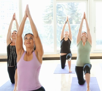 Yoga class being led by an instructor